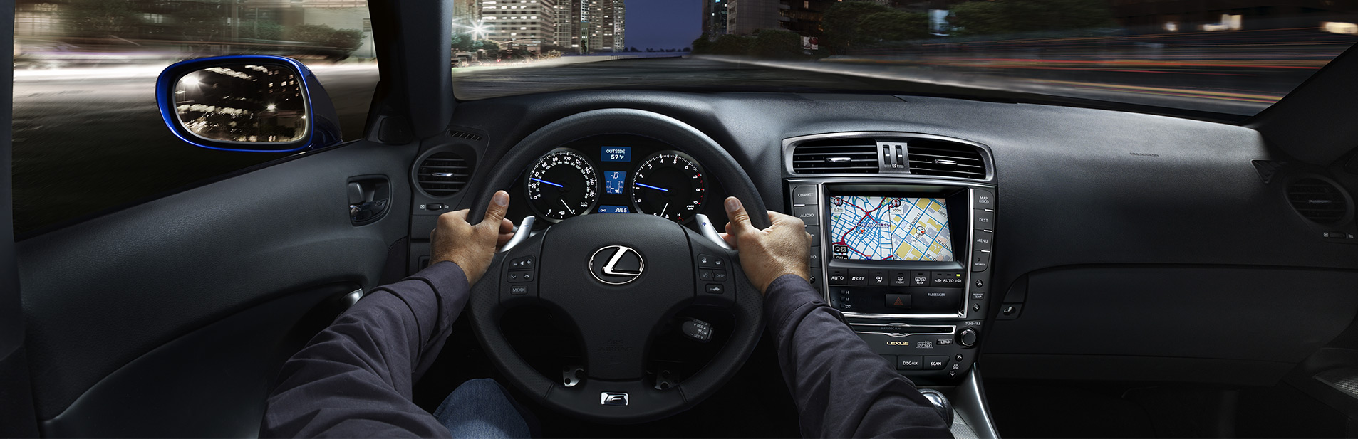 hands on the wheel of a lexus