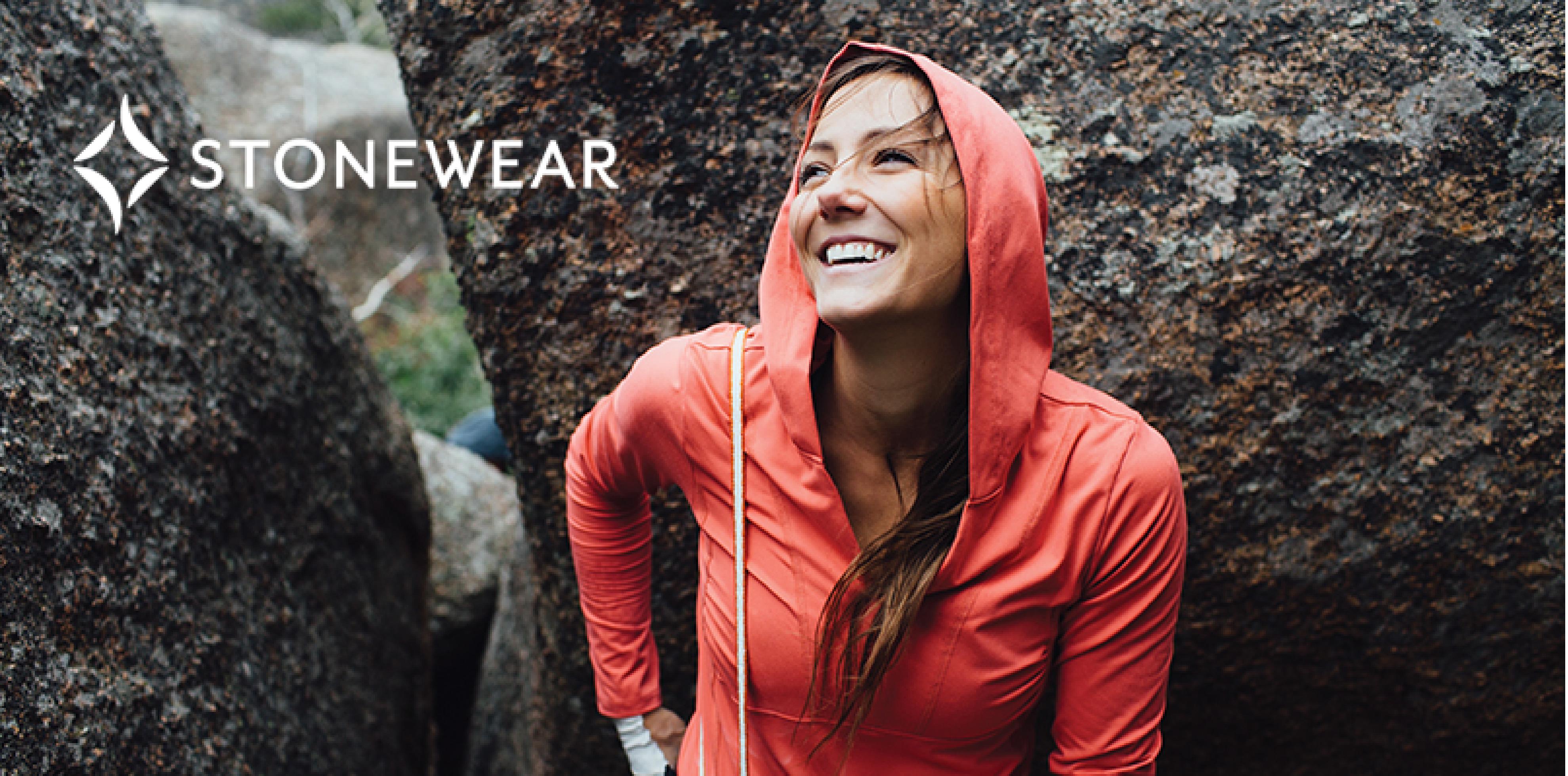 smiling woman wearing stonewear hoodie