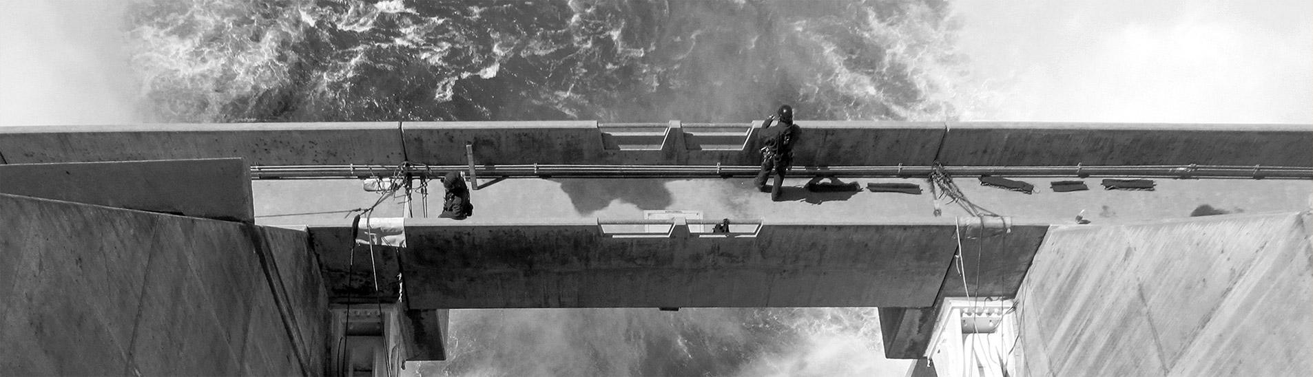 man on dam bridge